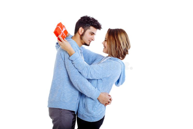 Man giving a gift to a woman, holding her royalty free stock photography