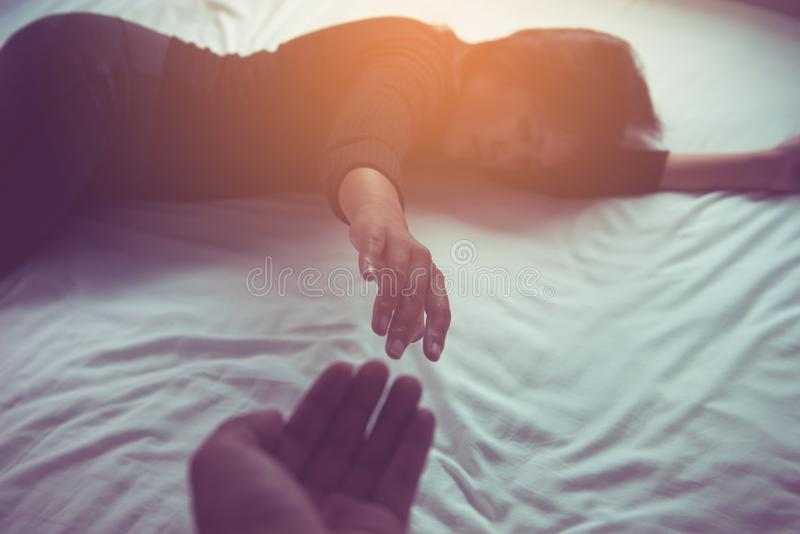 Man giving hand to depressed woman patient. Mental health care concept royalty free stock photos