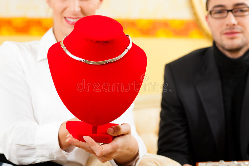 Download Man Giving His Wife A Necklace Stock Image - Image of attentive, heirloom: 24874745
