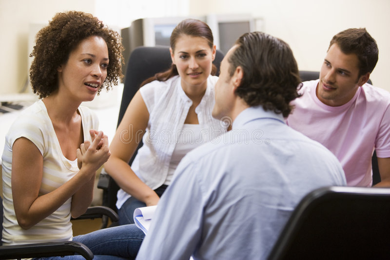 Man giving lecture to three people royalty free stock photo