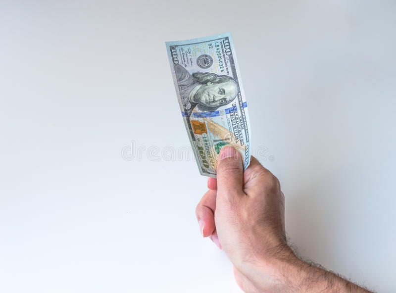 Man giving one hundred US Dollars. Man holding one hundred US Dollars stock photos