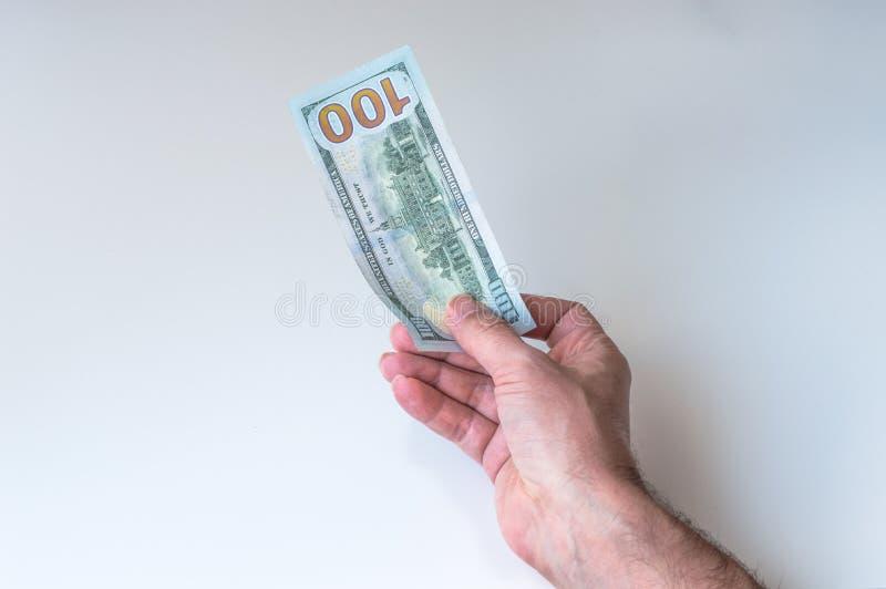 Man giving one hundred US Dollars. Man holding one hundred US Dollars royalty free stock photos