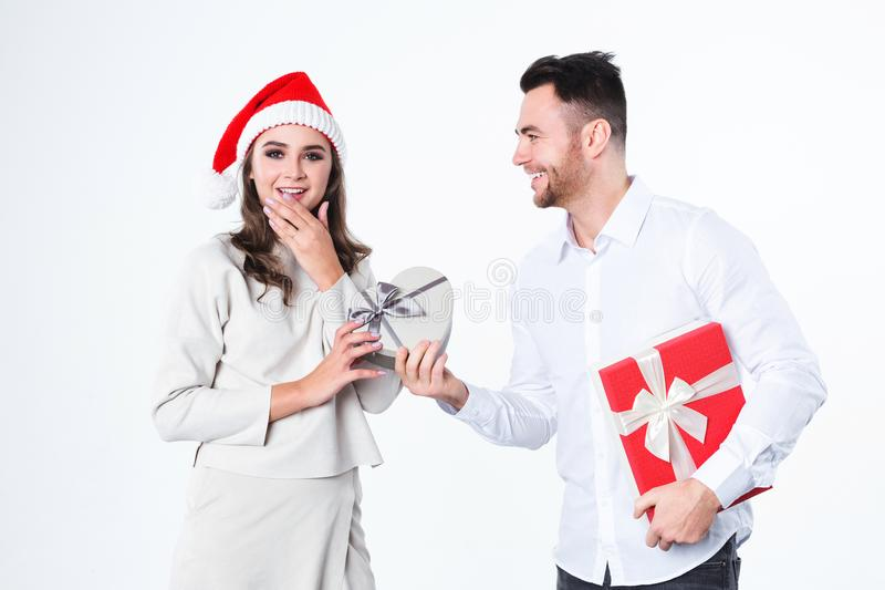 Man giving present to his girlfriend. Christmas gifts. stock images