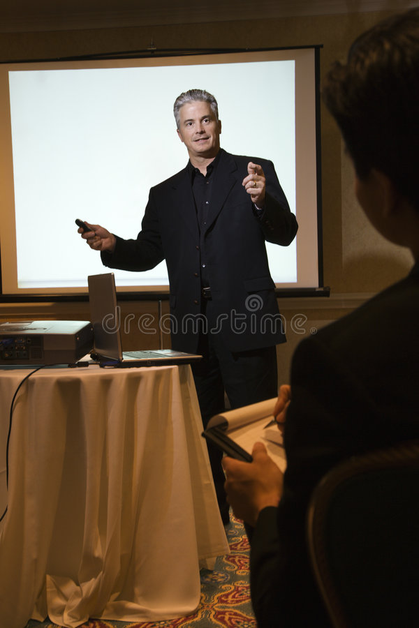 Man giving presentation. stock photos