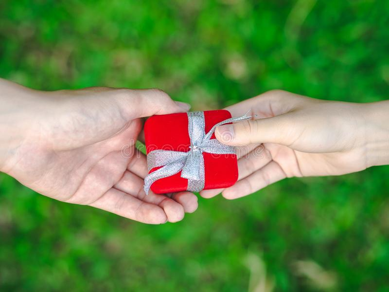 Man giving a red gift box to woman. Love, Valentine,Present Concept stock photo