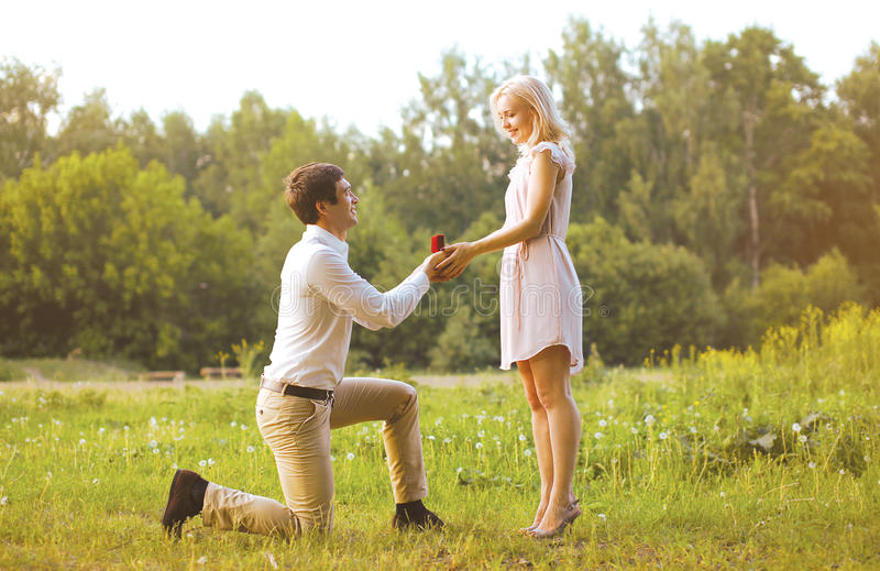 Man giving a ring woman, love, couple, date, wedding - concept. Outdoors royalty free stock photos