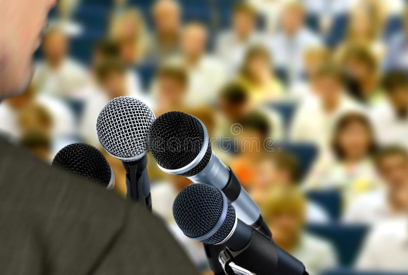 Man giving speech during seminar royalty free stock photography