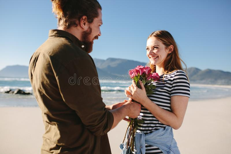 Man surprising girlfriend on a romantic date stock photos