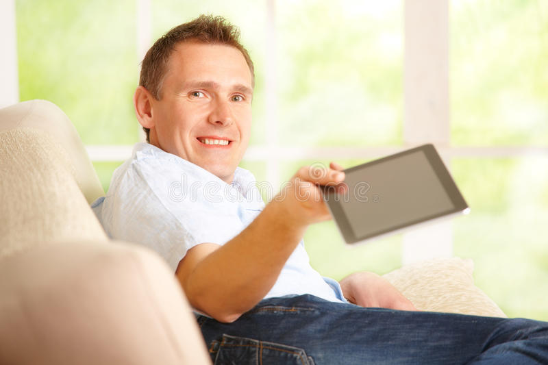 Download Man giving tablet stock photo. Image of leisure, home - 24317950