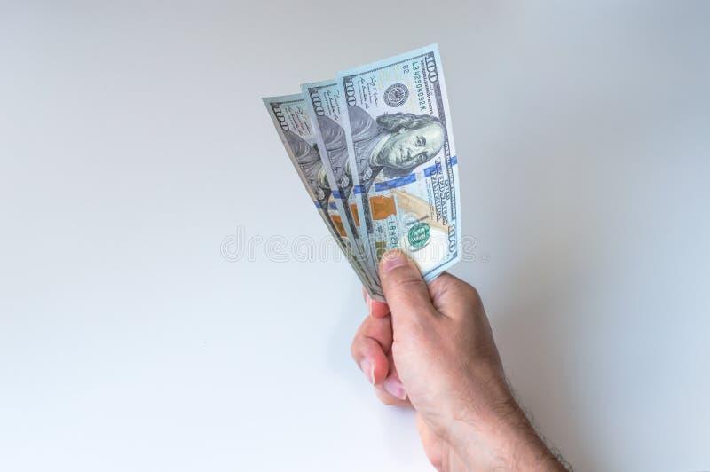 Man giving three hundred US Dollars. Man holding three hundred US Dollars stock photos