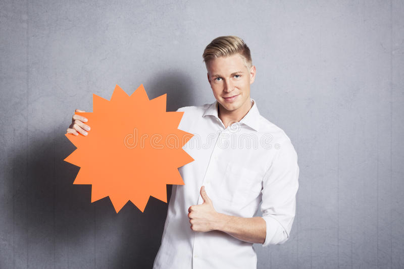 Man giving thumbs up at empty sign. royalty free stock photo