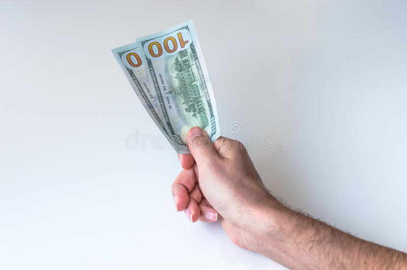 Man giving two hundred US Dollars. Man holding two hundred US Dollars stock photo
