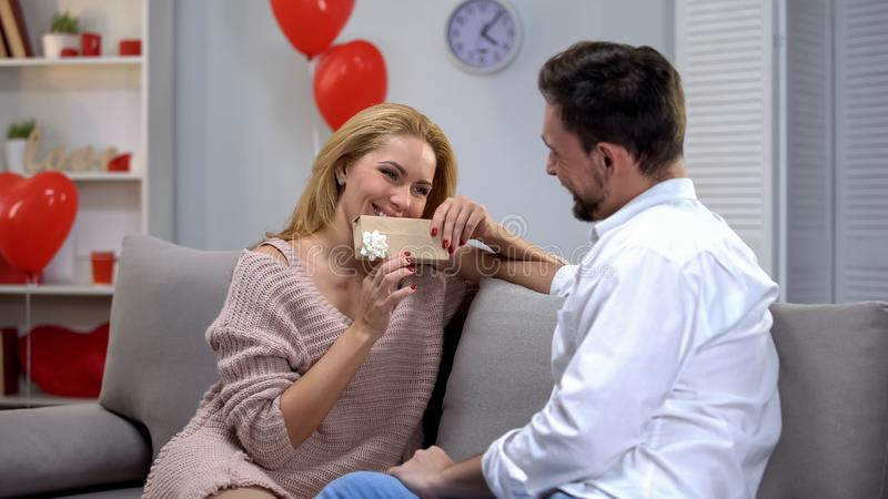 Man giving wife box with precious present, celebrating wedding anniversary, love. Stock photo stock images