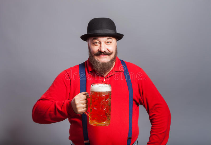 A man with a glass of beer stock image