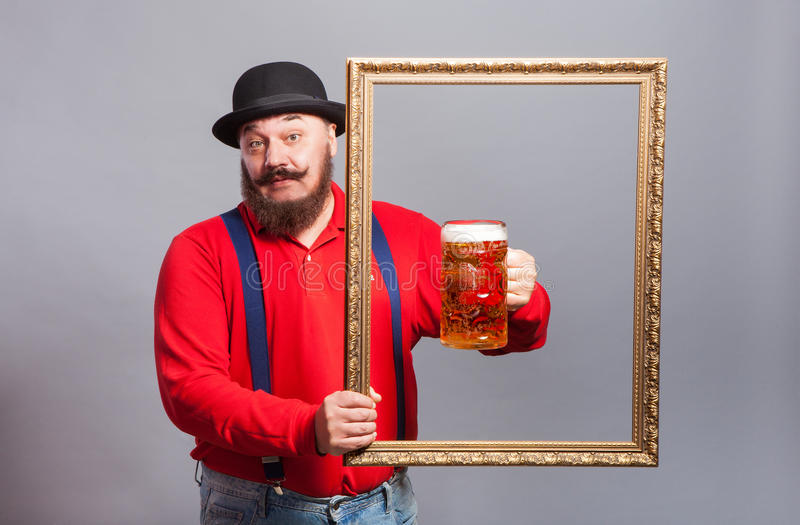 A man with a glass of beer royalty free stock image
