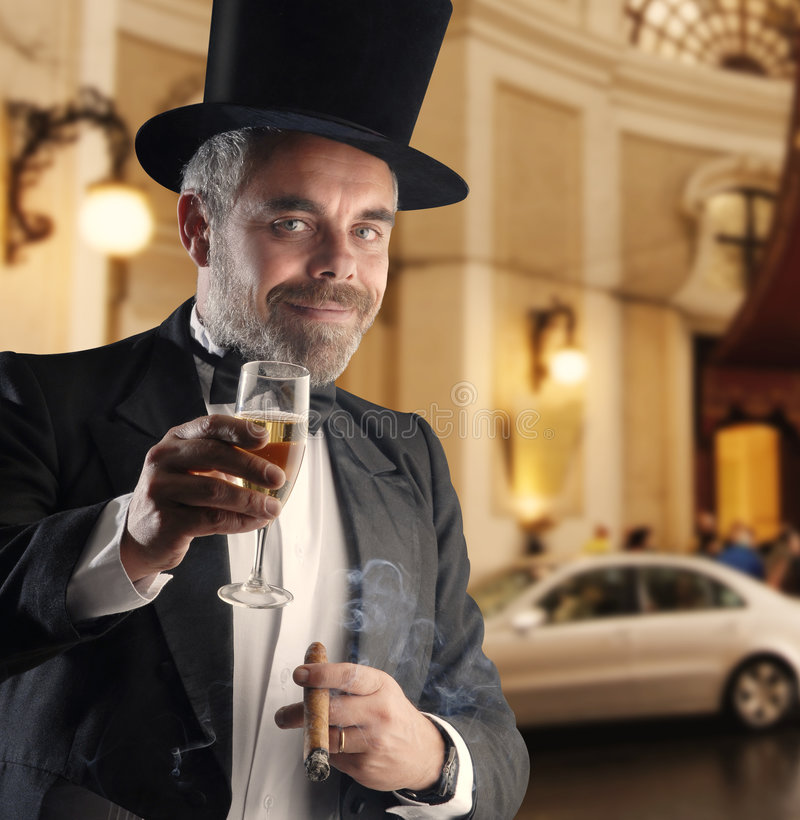 Man With Glass And Cigar Stock Images