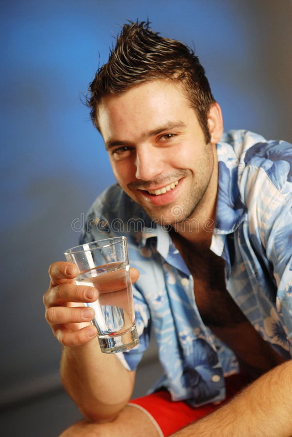 Download A Man With A Glass Of Water Stock Photo - Image: 3368640