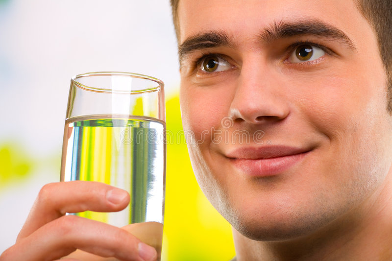 Man with glass of water stock images