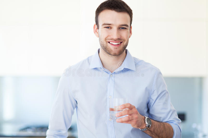 Man with glass of water