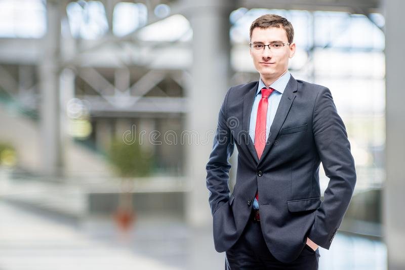 Man in glasses and business suit 25 years of age royalty free stock images