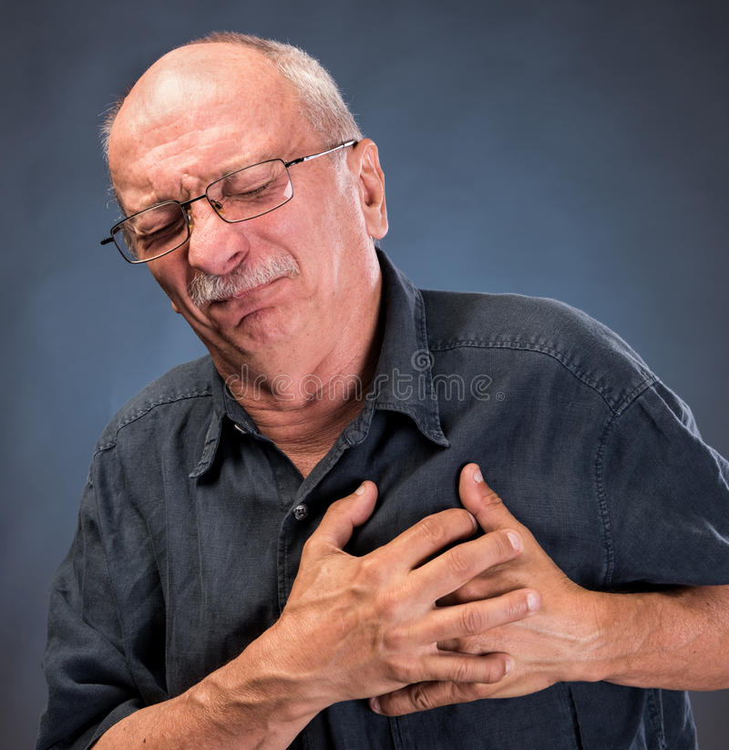 Man in glasses having a heart attack royalty free stock photo