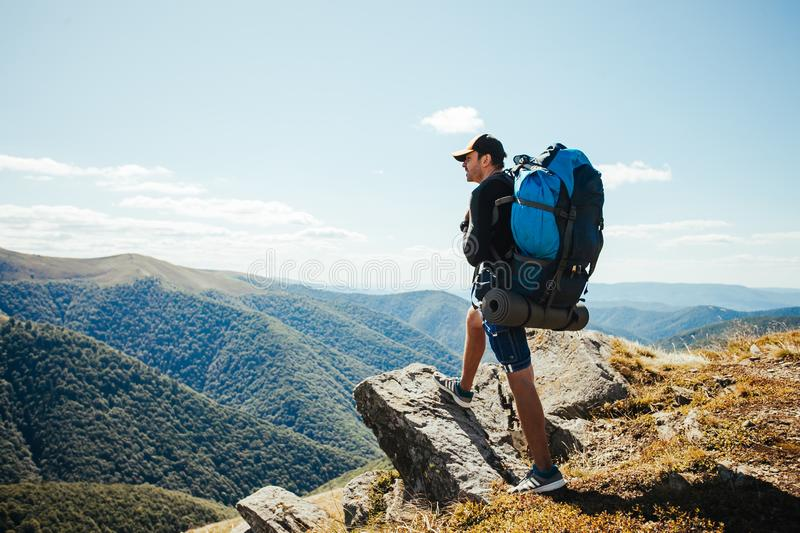 Man goes hiking in the mountains. Alone royalty free stock photo