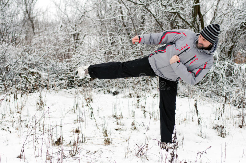 Man goes in for sports in winter outdoors royalty free stock photos