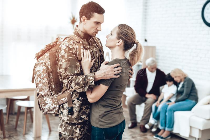 A Man Goes To Military Service. Family Goodbye. stock photo