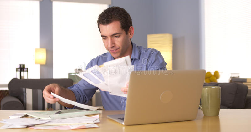 Man going over his finances at home stock photography