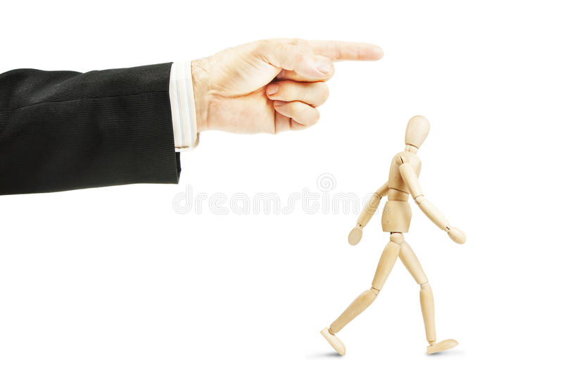 Man going in shown direction. Concept of obedience. Man going in shown direction. Concept of full obedience. Abstract image with a wooden puppet stock photos