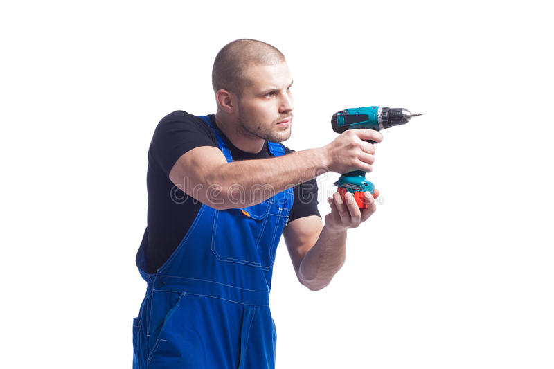 Man going to work with a green screwdriver stock image