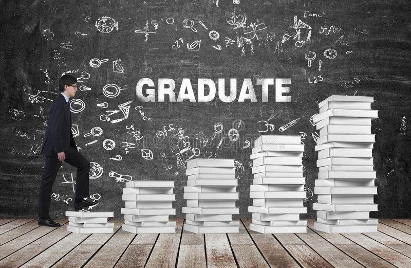 A man is going up using a stairs which are made of white books. The word graduate is on the black chalkboard. royalty free stock photography