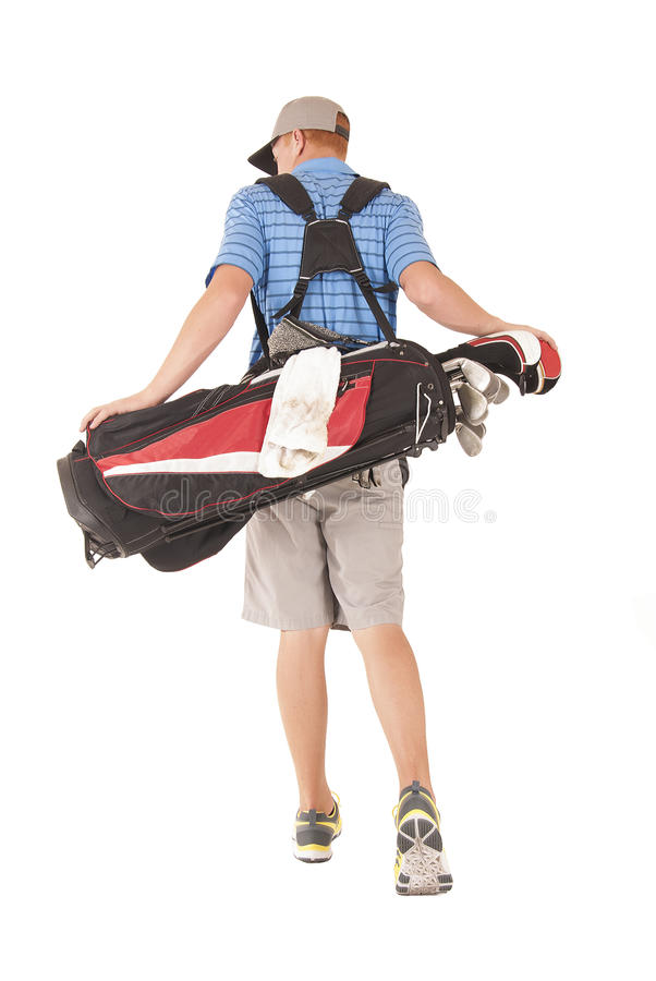Man with golf bag walking away from the camera stock images