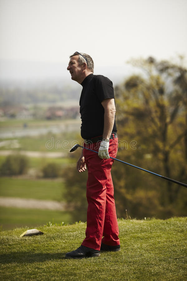 Man With Golf Club Waiting On The Green Royalty Free Stock