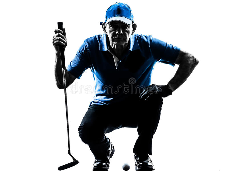Man golfer golfing crouching silhouette. One man golfer golfing crouching in silhouette studio isolated on white background stock images