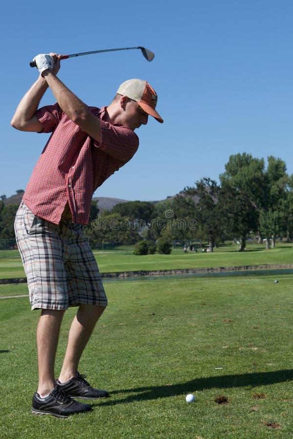 Man Golfing royalty free stock image