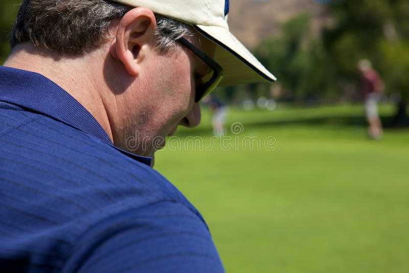 Man Golfing stock photography