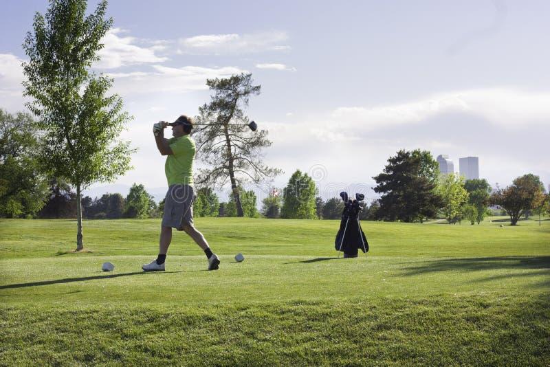 Man golfing at City Park, Denver, Colorado stock image
