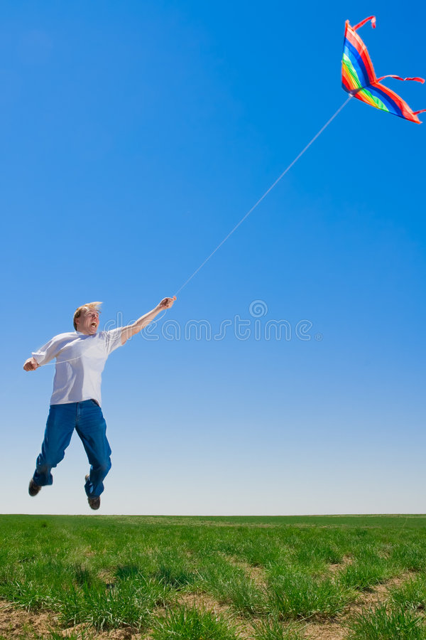 Download Man gone with kite stock photo. Image of green, shock - 5142288
