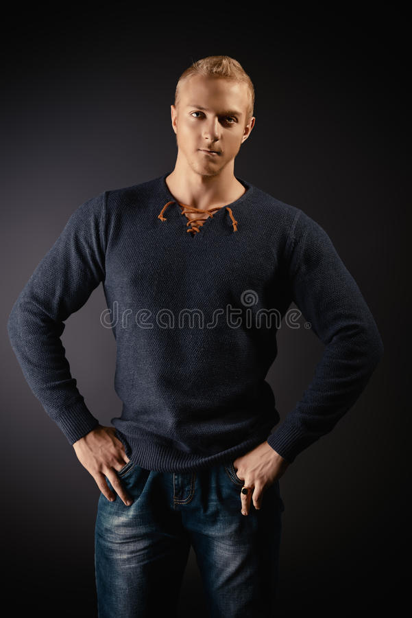 Man goodlooking. Fashion portrait of young masciline man posing over dark background stock photography