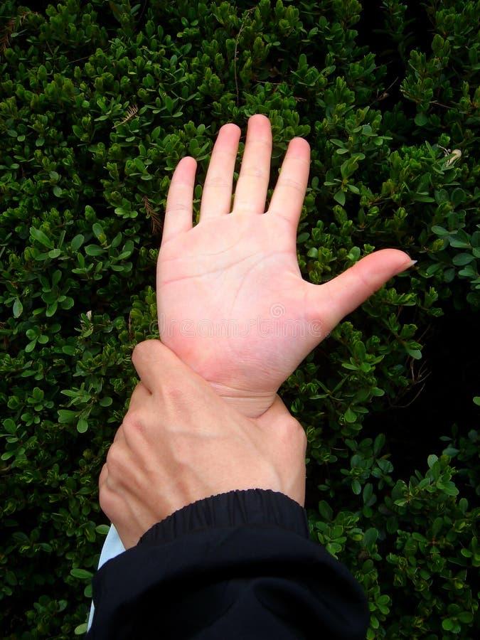 Man grabbing woman hand