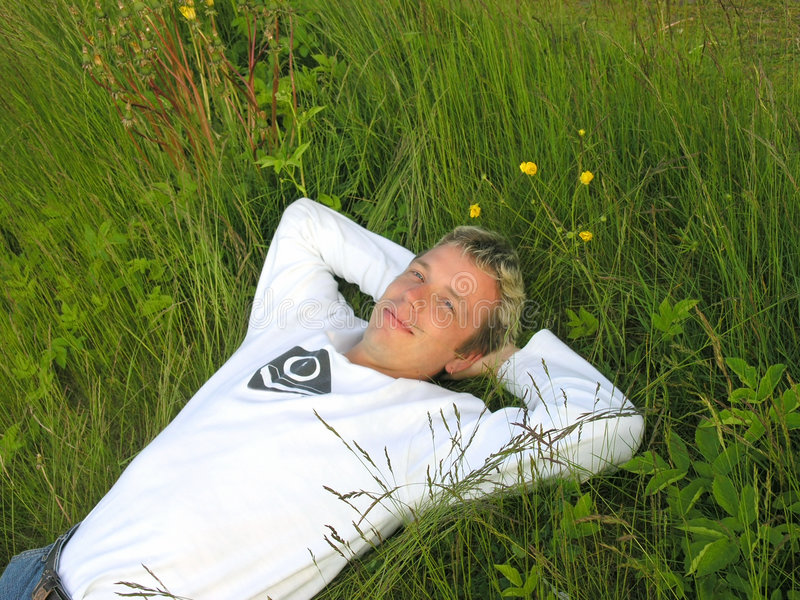 Man in the grass 2 royalty free stock photos