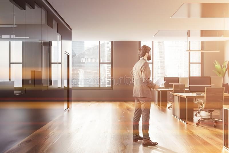 Man in gray and glass open space office interior royalty free stock photography