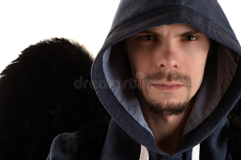 Man in gray hooded and black wing of right shoulder royalty free stock image