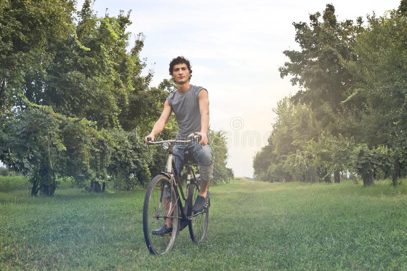 Man in Gray Sleeveless Shirt Riding Bike royalty free stock photography