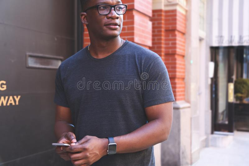 Man in Gray T-shirt Near Black Metal Wall royalty free stock images