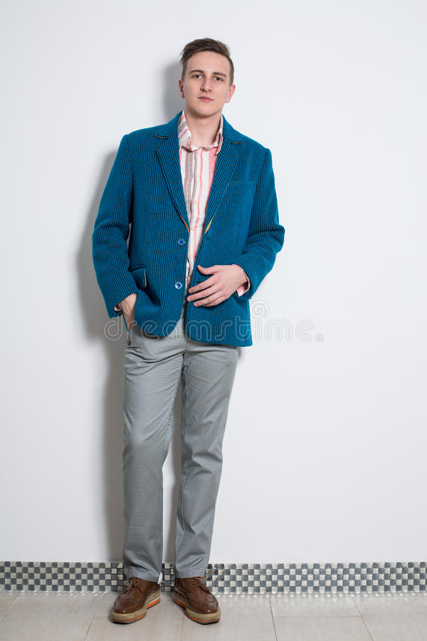 The man in gray trousers and a cyan jacket stock images