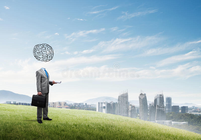 Man of great mind. Faceless businessman with drawn brain instead of head royalty free stock image