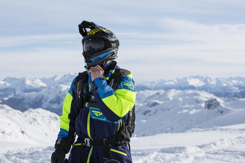 Man in Green and Blue Jacket Standing on Winter Season stock photo