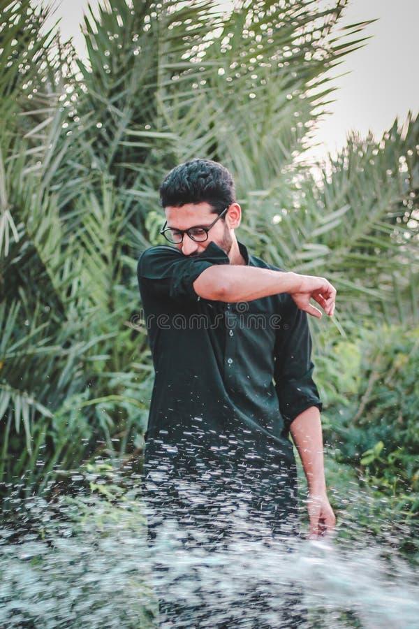 Man in Green Dress Shirt Near Palm Trees stock image